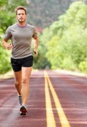 Sport and fitness runner man running on road training for marath